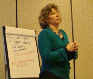 Carolyn speaking at faciliting retreat